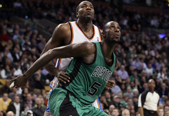 BOSTON, MA - JANUARY 16:  Kevin Garnett #5 of the Boston Celtics boxes out Kendrick Perkins #5 of the Oklahoma City Thunder on January 16, 2012 at TD Garden in Boston, Massachusetts. The Oklahoma City Thunder defeated the Boston Celtics 97-88. NOTE TO USE