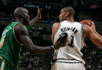 SAN ANTONIO - MARCH 17:  Forward Tim Duncan #21 of the San Antonio Spurs moves the ball against Kevin Garnett #5 of the Boston Celtics at AT&T Center March 17, 2008 in San Antonio, Texas.  NOTE TO USER: User expressly acknowledges and agrees that, by down