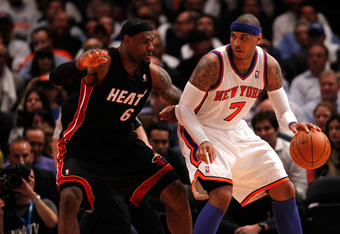 NEW YORK, NY - MAY 03:  Carmelo Anthony #7 of the New York Knicks posts up against LeBron James #6 of the Miami Heat in Game Three of the Eastern Conference Quarterfinals in the 2012 NBA Playoffs on May 3, 2012 at Madison Square Garden in New York City.