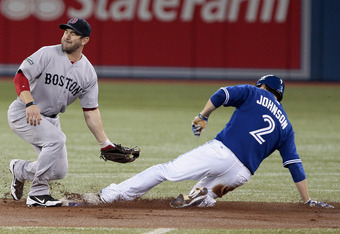 Kelly Johnson slides into second base during Toronto's 5-1 win over Boston on June 3.