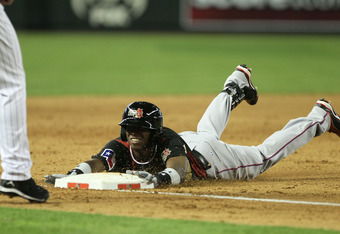 PHOENIX, AZ - JULY 10:  World Future's All-Star Jurickson Profar #10 of the Texas Rangers slides safely into third base during the 2011 XM All-Star Futures Game at Chase Field on July 10, 2011 in Phoenix, Arizona.  (Photo by Jeff Gross/Getty Images)