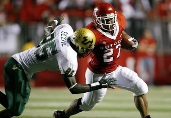 PISCATAWAY, NJ - OCTOBER 18:  Ray Rice #27 of the Rutgers Scarlet Knights tries to get by DE George Selvie #95 of the South Florida Bulls in the first half of a game at Rutgers Stadium October 18, 2007 in Piscataway, New Jersey. (Photo by Jeff Zelevansky/