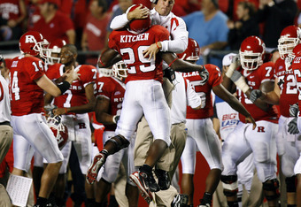 PISCATAWAY, NJ - OCTOBER 18: Zaire Kitchen #29 of the Rutgers Scarlet Knights jumps into the arms of assistant coach Chris Demarest after his interception in the fourth quarter against the South Florida Bulls in a game at Rutgers Stadium October 18, 2007