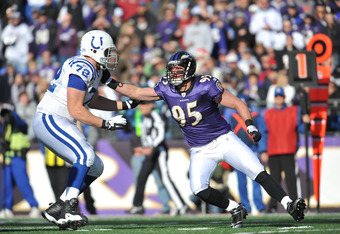 BALTIMORE - DECEMBER 11:  Jarrett Johnson #95 of the Baltimore Ravens defends against Jeff Linkenbach #72 of the Indianapolis Colts at M&T Bank Stadium on December 11, 2011 in Baltimore, Maryland. The Ravens defeated the Colts 24-10. (Photo by Larry Frenc