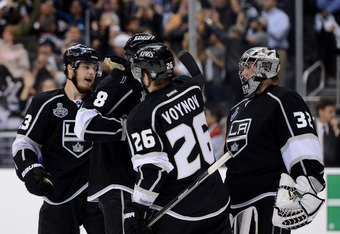 LOS ANGELES, CA - JUNE 04:  (L-R) Dustin Brown #23, Drew Doughty #8, Slava Voynov #26 and goaltender Jonathan Quick #32 of the Los Angeles Kings congratulate one another after Game Three of the 2012 Stanley Cup Final against the New Jersey Devils at Stapl