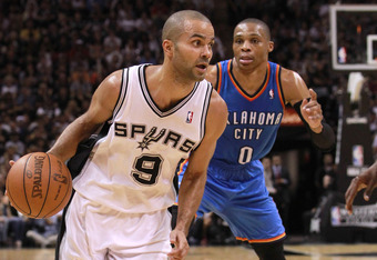 SAN ANTONIO, TX - MAY 29:  Tony Parker #9 of the San Antonio Spurs drives ahead of Russell Westbrook #0 of the Oklahoma City Thunder in Game Two of the Western Conference Finals of the 2012 NBA Playoffs at AT&T Center on May 29, 2012 in San Antonio, Texas