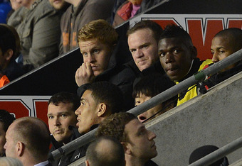 WIGAN, ENGLAND - APRIL 11:  Wayne Rooney of Manchester United sits on the bench after being substituted during the Barclays Premier League match between Wigan Athletic and Manchester United at the DW Stadium on April 11, 2012 in Wigan, England.  (Photo by