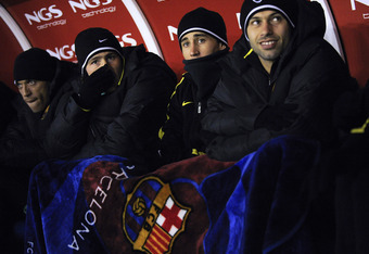 PAMPLONA, SPAIN - DECEMBER 04:  FC Barcelona players warm up on the bench during the La Liga match between CA Osasuna and Barcelona at Estadio Reyno de Navarra on December 4, 2010 in Pamplona, Spain. Barcelona won 0-3.  (Photo by David Ramos/Getty Images)