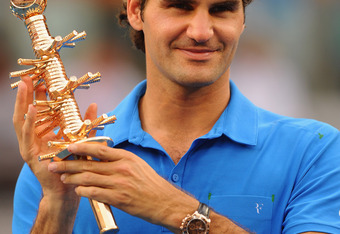 MADRID, SPAIN - MAY 13:  Roger Federer of Switzerland holds aloft the winner's trophy after his victory over Tomas Berdych of Czech Republic in the Men's Single Final on Day Nine of the Mutua Madrilena Madrid Open at the Caja Magica on May 13, 2012 in Mad