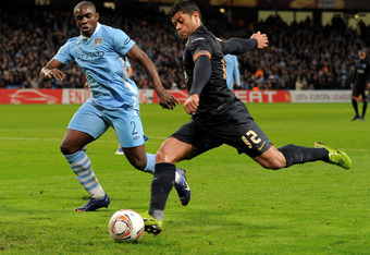 MANCHESTER, ENGLAND - FEBRUARY 22:  Micah Richards of Manchester City competes with Hulk of FC Porto during the UEFA Europa League Round of 32 second leg match between Manchester City and FC Porto at the Etihad Stadium on February 22, 2012 in Manchester,