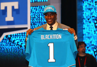 NEW YORK, NY - APRIL 26:  Justin Blackmon from Oklahoma State holds up a jersey as he stands on stage after he was selected #5 overall by the Jacksonville Jaguars in the first round of the 2012 NFL Draft at Radio City Music Hall on April 26, 2012 in New Y