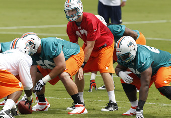 DAVIE, FL - MAY 4: Ryan Tannehill #17 takes a snap from Terrence Brown #60 of the Miami Dolphins during the rookie minicamp on May 4, 2012 at the Miami Dolphins training facility in Davie, Florida. (Photo by Joel Auerbach/Getty Images)