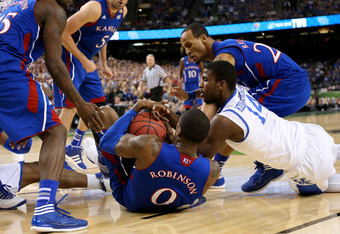 NEW ORLEANS, LA - APRIL 02:  Thomas Robinson #0 of the Kansas Jayhawks with the ball as Michael Kidd-Gilchrist #14 of the Kentucky Wildcats goes after it in the first half in the National Championship Game of the 2012 NCAA Division I Men's Basketball Tour