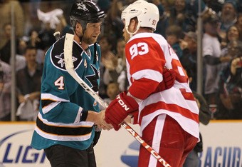 SAN JOSE, CA - MAY 8: Rob Blake #4 of the San Jose Sharks shakes hands with Johan Franzen #93 of the Detroit Red Wings after Game Five of the Western Conference Semifinals during the 2010 NHL Stanley Cup Playoffs at HP Pavilion on May 8, 2010 in San Jose,