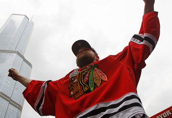 CHICAGO - JUNE 11: Antti Niemi #31 waves the crowd during the Chicago Blackhawks Stanley Cup victory parade and rally on June 11, 2010 in Chicago, Illinois. (Photo by Jonathan Daniel/Getty Images)