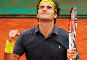 PARIS, FRANCE - JUNE 05:  Roger Federer of Switzerland celebrates victory in his men's singles quarter final match against Juan Martin Del Potro of Argentina during day 10 of the French Open at Roland Garros on June 5, 2012 in Paris, France.  (Photo by Mi
