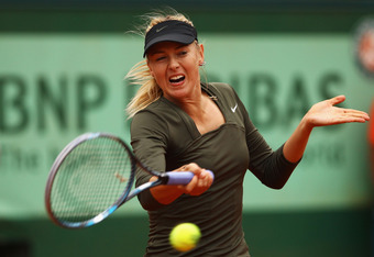 PARIS, FRANCE - JUNE 04:  Maria Sharapova of Russia in action during her women's singles fourth round match against Klara Zakopalova of Czech Republic during day 9 of the French Open at Roland Garros on June 4, 2012 in Paris, France.  (Photo by Clive Brun