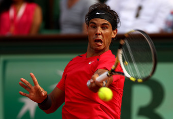 PARIS, FRANCE - JUNE 02:  Rafael Nadal of Spain plays a forehand during his men's singles third round match against Eduardo Schwank of Argentina during day seven of the French Open at Roland Garros on June 2, 2012 in Paris, France.  (Photo by Clive Brunsk