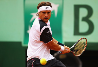 PARIS, FRANCE - JUNE 04:  David Ferrer of Spain plays a backhand in his men's singles fourth round match against Marcel Granollers of Spain during day 9 of the French Open at Roland Garros on June 4, 2012 in Paris, France.  (Photo by Clive Brunskill/Getty