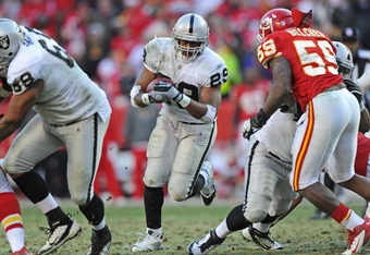 KANSAS CITY, MO - DECEMBER 24:  Running back Michael Bush #29 of the Oakland Raiders rushes up field against the Kansas City Chiefs during overtime on December 24, 2011 at Arrowhead Stadium in Kansas City, Missouri.  Oakland defeated Kansas City 16-13 in