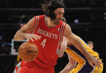 LOS ANGELES, CA - APRIL 06:  Luis Scola #4 of the Houston Rockets spins free from Paul Gasol #16 of the Los Angeles Lakers during a 112-107 Rocets win at Staples Center on April 6, 2012 in Los Angeles, California.  NOTE TO USER: User expressly acknowledge