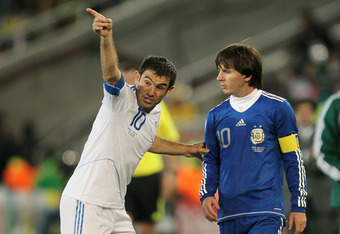 POLOKWANE, SOUTH AFRICA - JUNE 22: Giorgias Karagounis of Greece gestures to Lionel Messi of Argentina during the 2010 FIFA World Cup South Africa Group B match between Greece and Argentina at Peter Mokaba Stadium on June 22, 2010 in Polokwane, South Afri