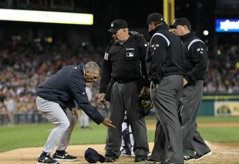 Joe Girardi giving the umpires some pointers.