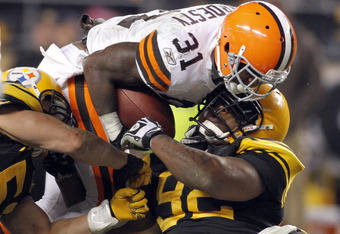 PITTSBURGH, PA - DECEMBER 8:   James Harrison #92 of the Pittsburgh Steelers tackles Montario Hardesty #31 of the Cleveland Browns during the game on December 8, 2011 at Heinz Field in Pittsburgh, Pennsylvania.  The Steelers won 14-3.  (Photo by Justin K.