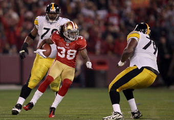 SAN FRANCISCO, CA - DECEMBER 19:  Safety Dashon Goldson #38 of the San Francisco 49ers returns the ball 21-yards after an interception in the first half against the Pittsburgh Steelers at Candlestick Park on December 19, 2011 in San Francisco, California.