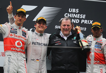 SHANGHAI, CHINA - APRIL 15:  Race winner Nico Rosberg (2nd left) of Germany and Mercedes GP celebrates with second placed Jenson Button (left) of Great Britain and McLaren, third placed Lewis Hamilton (right) of Great Britain and McLaren and Norbert Haug