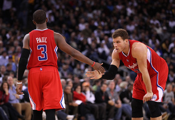 OAKLAND, CA - FEBRUARY 20:  Chris Paul #3 congratulates Blake Griffin #32 of the Los Angeles Clippers after Griffin was fouled during their game against the Golden State Warriors at Oracle Arena on February 20, 2012 in Oakland, California.  NOTE TO USER: