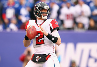 EAST RUTHERFORD, NJ - JANUARY 08:  Matt Ryan #2 of the Atlanta Falcons looks to pass against the New York Giants during their NFC Wild Card Playoff game at MetLife Stadium on January 8, 2012 in East Rutherford, New Jersey.  (Photo by Al Bello/Getty Images