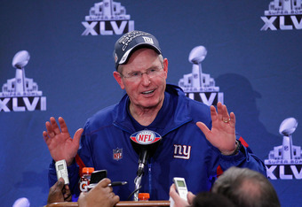INDIANAPOLIS, IN - FEBRUARY 05:  Head coach Tom Coughlin of the New York Giants talks with the media in a post game press conference after defeating the New England Patriots 21-17 during Super Bowl XLVI at Lucas Oil Stadium on February 5, 2012 in Indianap