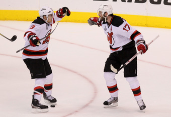 LOS ANGELES, CA - JUNE 06:  Zach Parise #9 and Ilya Kovalchuk #17 of the New Jersey Devils celebrate their fourth period empty net goal over the Los Angeles Kings in Game Four of the 2012 Stanley Cup Final at Staples Center on June 6, 2012 in Los Angeles,