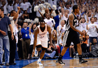 OKLAHOMA CITY, OK - JUNE 06:  James Harden #13 of the Oklahoma City Thunder reacts after hitting a three pointer late in the game against the San Antonio Spurs in Game Six of the Western Conference Finals of the 2012 NBA Playoffs at Chesapeake Energy Aren