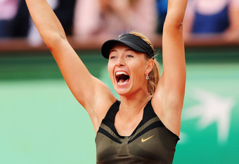PARIS, FRANCE - JUNE 06:  Maria Sharapova of Russia celebrates victory in her women's singles quarter final match against Kaia Kanepi of Estonia during day 11 of the French Open at Roland Garros on June 6, 2012 in Paris, France.  (Photo by Mike Hewitt/Get