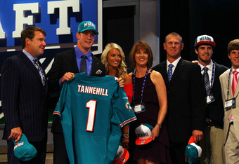 NEW YORK, NY - APRIL 26:  Ryan Tannehill from Texas A&M holds up a jersey as he stands on stage with family and friends including his wife Lauren after he was selected #8 overall by the Miami Dolphins in the first round of during the 2012 NFL Draft at Rad