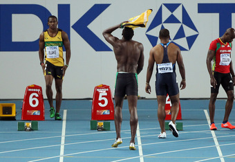 Bolt ripped off his shirt and hung his head in his hands after being disqualified in South Korea.