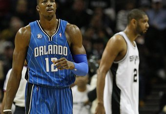 SAN ANTONIO - JANUARY 11:  Dwight Howard #12 of the Orlando Magic during play against the San Antonio Spurs on January 11, 2009 at AT&T Center in San Antonio, Texas.  NOTE TO USER: User expressly acknowledges and agrees that, by downloading and/or using t