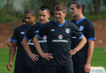 LONDON COLNEY, ENGLAND - MAY 29: Glen Johnson, John Terry, Steven Gerrard and Andy Carroll look on during the England training session on May 29, 2012 in London Colney, England.  (Photo by Michael Regan/Getty Images)