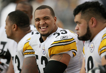 GLENDALE, AZ - OCTOBER 23:  Center Maurkice Pouncey #53 of the Pittsburgh Steelers laughs while Chris Kemoeatu #68 looks on from the bench during their game against the Arizona Cardinals at University of Phoenix Stadium on October 23, 2011 in Glendale, Ar