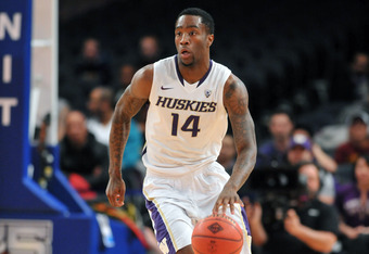 NEW YORK, NY - MARCH 27: Tony Wroten #14 of the Washington Huskies controls the ball in the first half during the semifinals of the 2012 NCAA NIT Men's Basketball Championship against the Minnesota Golden Golphers at Madison Square Garden on March 27, 201