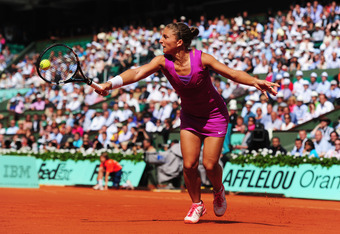 PARIS, FRANCE - JUNE 07:  Sara Errani of Italy plays a backhand in her women's semi final match against Samantha Stosur of Australia during day 12 of the French Open at Roland Garros on June 7, 2012 in Paris, France.  (Photo by Mike Hewitt/Getty Images)