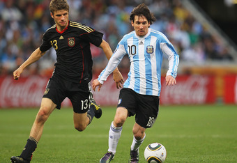 CAPE TOWN, SOUTH AFRICA - JULY 03:  Lionel Messi of Argentina is closed down by Thomas Mueller of Germany during the 2010 FIFA World Cup South Africa Quarter Final match between Argentina and Germany at Green Point Stadium on July 3, 2010 in Cape Town, So