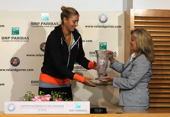 PARIS, FRANCE - JUNE 07:  Maria Sharapova of Russia receives a trophy from WTA CEO Stacey Allaster after becoming the WTA world number one after her women's semi final match against Petra Kvitova of Czech Republic during day 12 of the French Open at Rolan
