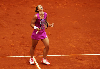PARIS, FRANCE - JUNE 07:  Sara Errani of Italy celebrates victory in her women's semi final match against Samantha Stosur of Australia during day 12 of the French Open at Roland Garros on June 7, 2012 in Paris, France.  (Photo by Matthew Stockman/Getty Im