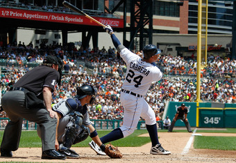 DETROIT, MI - JUNE 07:  Miguel Cabrera #24 of the Detroit Tigers watches a fourth inning home run in front of Lou Marson #6 of the Cleveland Indians at Comerica Park on June 7, 2012 in Detroit, Michigan.  (Photo by Gregory Shamus/Getty Images)