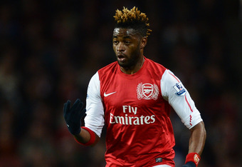 LONDON, ENGLAND - APRIL 16:  Alex Song of Arsenal on the ball during the Barclays Premier League match between Arsenal and Wigan Athletic at Emirates Stadium on April 16, 2012 in London, England.  (Photo by Laurence Griffiths/Getty Images)