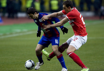 MOSCOW, RUSSIA - MARCH 19: Alan Dzagoev (L) of FC Spartak Moscow battles for the ball with Artem Dzyuba of PFC CSKA Moscow during the Russian Football League Championship match between FC Spartak Moscow and PFC CSKA Moscow at the Luzhniki Stadium on March
