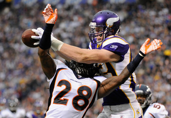 MINNEAPOLIS, MN - DECEMBER 4: Kyle Rudolph #82 of the Minnesota Vikings catches the ball over Quinton Carter #28 of the Denver Broncos for a touchdown in the second quarter on December 4, 2011 at Mall of America Field at the Hubert H. Humphrey Metrodome i